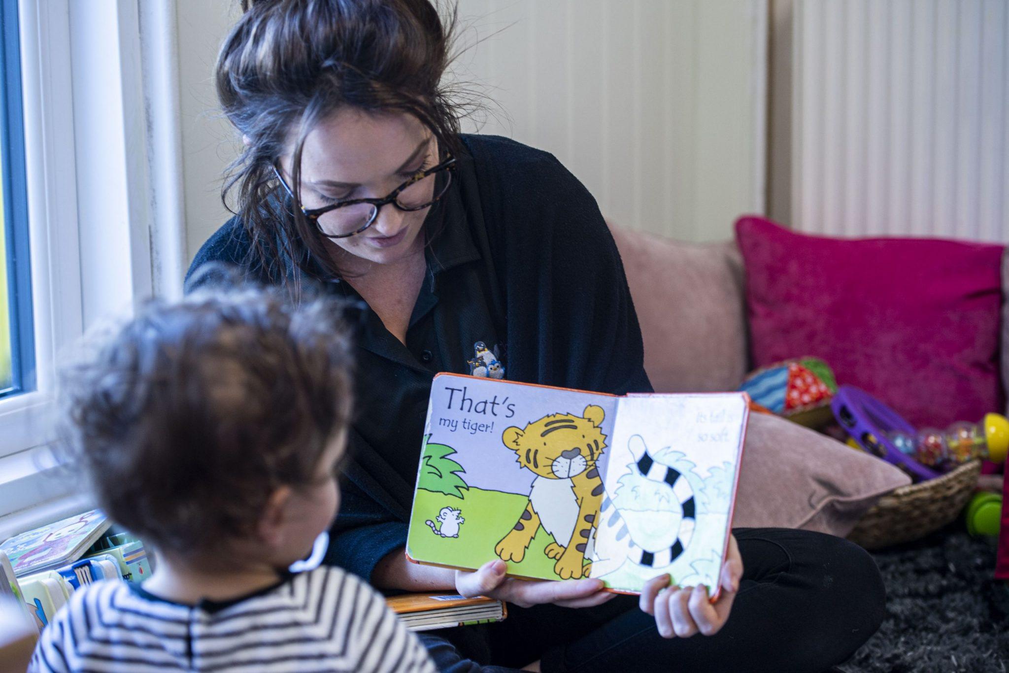 Reading books at nursery