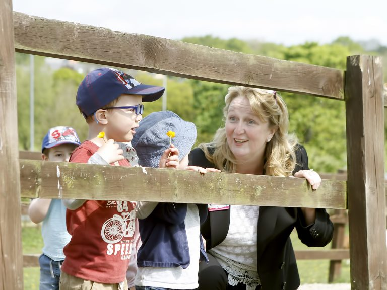 Children talking with staff member