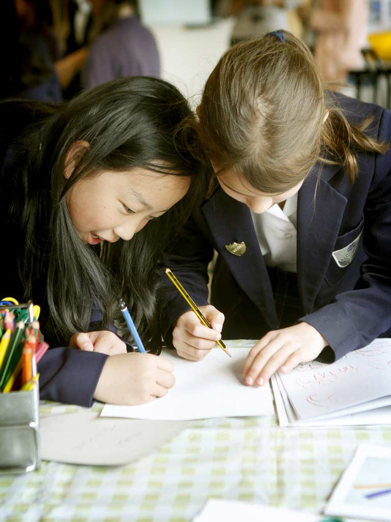 Children writing together