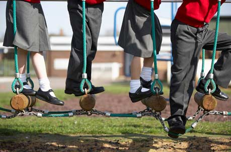 Children playing on outdoor equipment