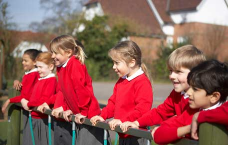 School children looking out over a fence