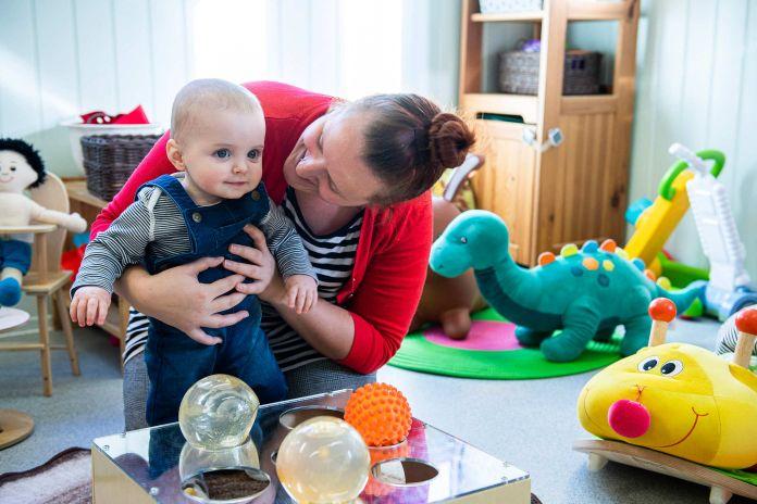Carer Helps Baby Walk