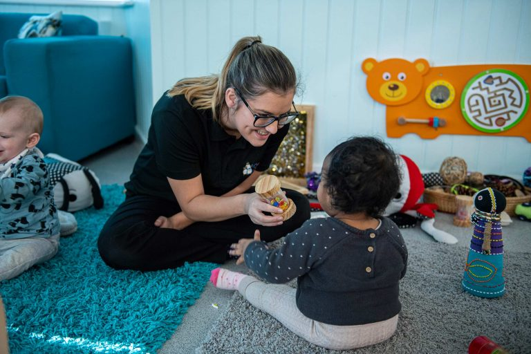 Carer and Child playing with toys