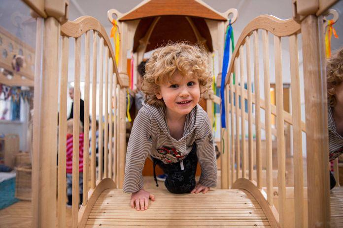 Child playing on indoor playground