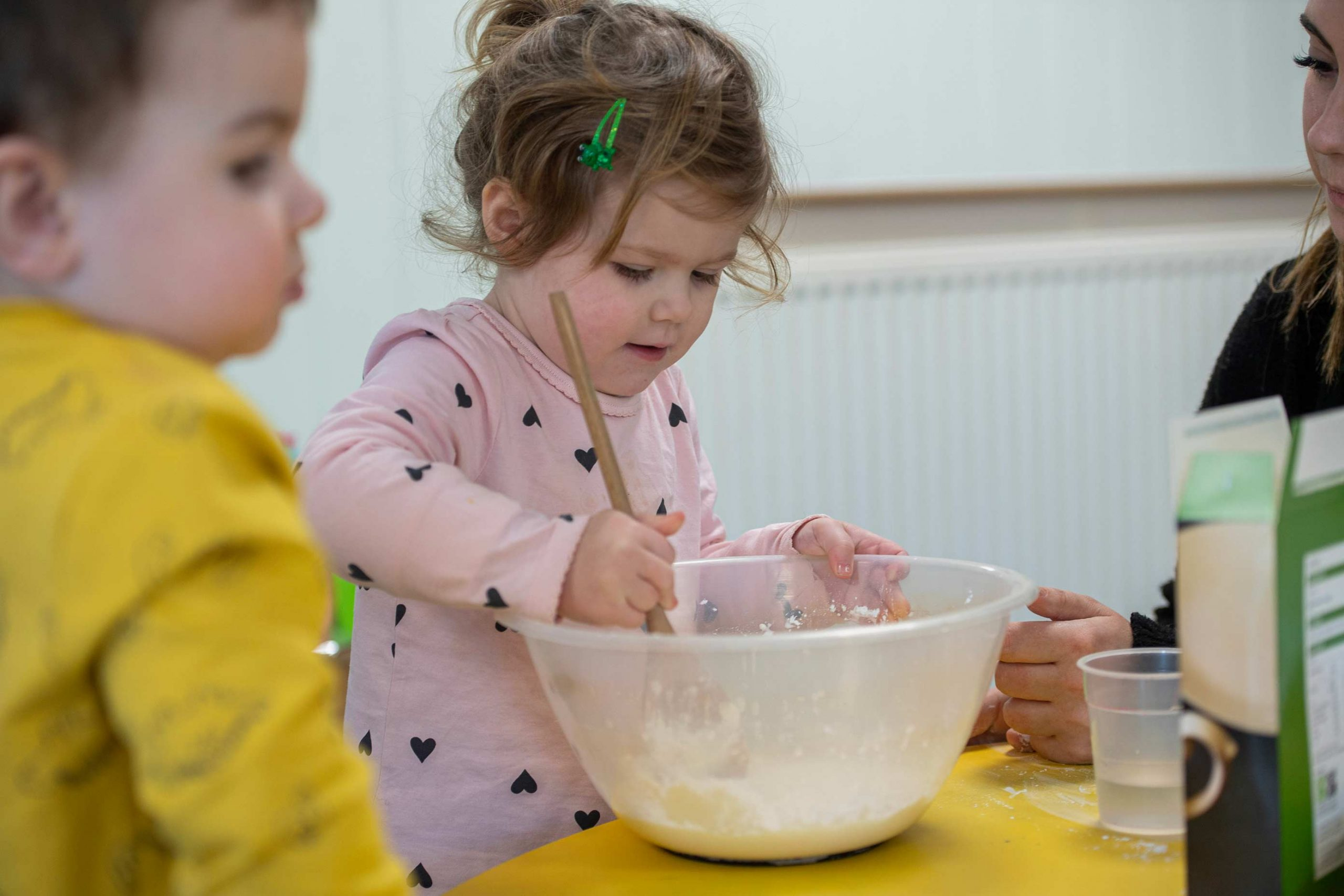 Child with mixing bowl